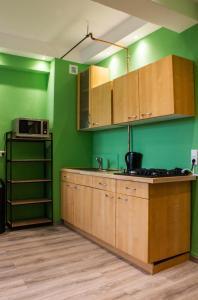 A kitchen or kitchenette at Shiva's CitySleep