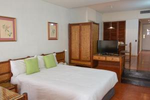 A bed or beds in a room at Edificio Corrientes 1856