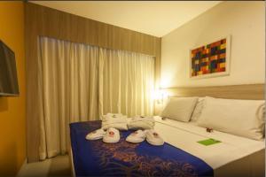 A bed or beds in a room at Lindo Flat em Boa Viagem
