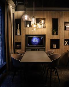 Télévision ou salle de divertissement dans l'établissement Comfort Hotel Xpress Central Station