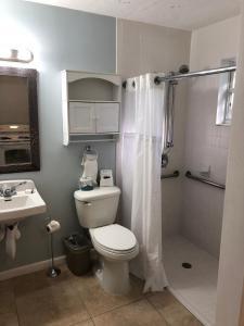 A bathroom at Marco Island Lakeside Inn