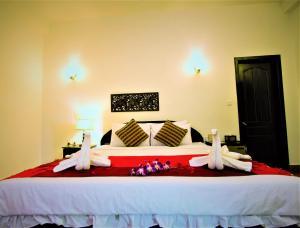 Een bed of bedden in een kamer bij Sonalong Boutique Village & Resort