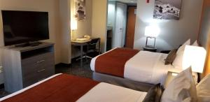 A bed or beds in a room at Best Western Plus St. Augustine I-95