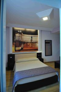 A bed or beds in a room at Hotel Star