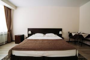Кровать или кровати в номере West Hotel