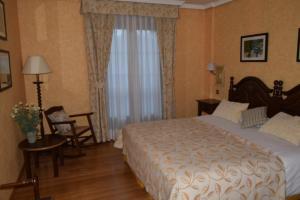 Cama o camas de una habitación en Hospederia La Cañada