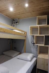 A bunk bed or bunk beds in a room at Hameau du Borsat