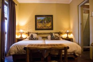 A bed or beds in a room at JAK Strydom Nature Reserve