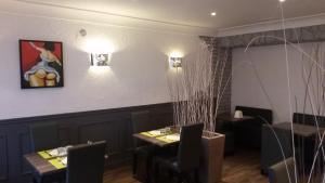 Restaurant ou autre lieu de restauration dans l'établissement Auberge des toqués