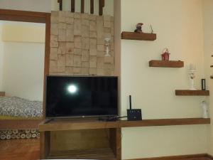 TV o dispositivi per l'intrattenimento presso Suncani apartman 26