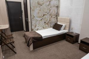 A bed or beds in a room at Hotel Marko