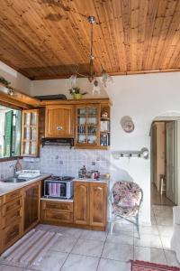 A kitchen or kitchenette at Kanoni Beach Apartments