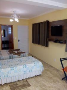 A bed or beds in a room at Chalés Pousada Serra Negra