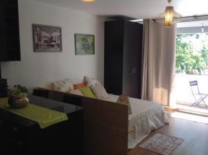 Uma área de estar em Studio Tiare Papeete centre