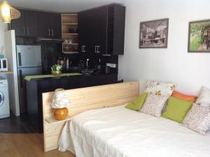 Cama ou camas em um quarto em Studio Tiare Papeete centre
