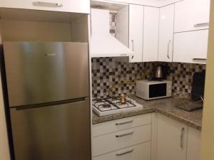 A kitchen or kitchenette at Ataa Family Apartments