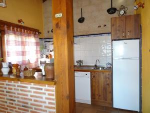 A kitchen or kitchenette at Balcon De Nut I y II
