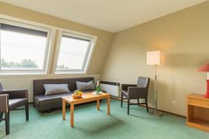 Een zitgedeelte bij Fletcher Resort-Hotel Amelander Kaap