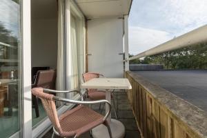 Een balkon of terras bij Fletcher Resort-Hotel Amelander Kaap