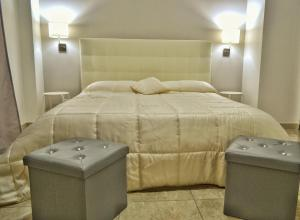 A bed or beds in a room at B&B Lungomare