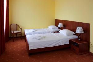 Кровать или кровати в номере Гостиница-А