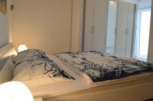 Letto o letti in una camera di Apartments Bellevue