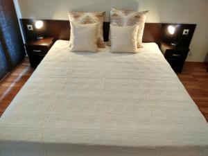 Ein Bett oder Betten in einem Zimmer der Unterkunft Sunset Beach