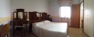 A bed or beds in a room at Locanda Sant'Anna Hotel
