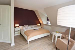 Ein Bett oder Betten in einem Zimmer der Unterkunft Fischerwiege am Passader See