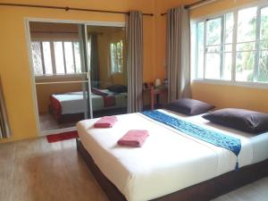 A bed or beds in a room at JJ Beach Resort & JJ Seafood