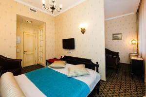 Кровать или кровати в номере Бутик отель Pastel'