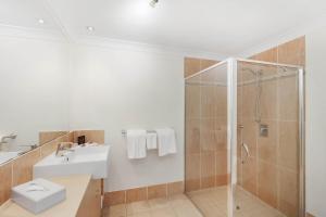 A bathroom at Mantra Aqueous on Port