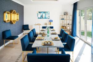 مطعم أو مكان آخر لتناول الطعام في Dream Inn - Executive Palm Beach Villa