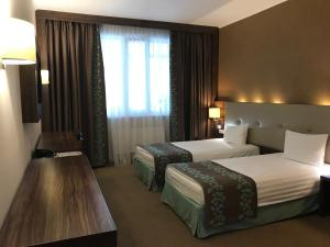 Кровать или кровати в номере Green Palace Vnukovo Hotel