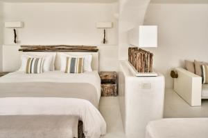 A bed or beds in a room at Mystique, a Luxury Collection Hotel, Santorini