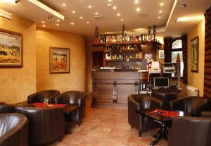 The lounge or bar area at Villa Akademik