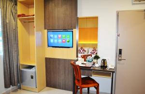 A television and/or entertainment center at City Central Hotel
