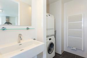 Ein Badezimmer in der Unterkunft Buitenplaats Witte Raaf aan Zee