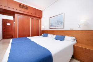Cama o camas de una habitación en Hotel Concorde