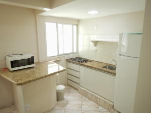 A kitchen or kitchenette at Quintana Flats