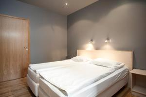 A bed or beds in a room at Hotel Hraun