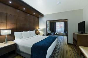 A bed or beds in a room at Oxford Suites Spokane Downtown