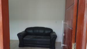 A seating area at APARTAMENTO DO OTTO