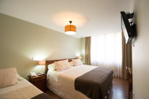 A bed or beds in a room at Hotel Loreto