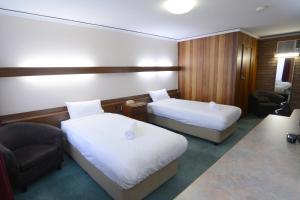 A bed or beds in a room at City Centre Motel