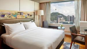 A bed or beds in a room at Lotte Hotel Seoul