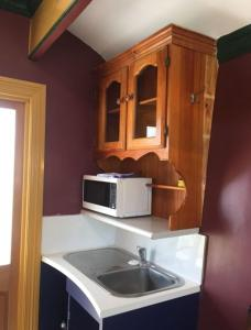 A kitchen or kitchenette at Glamping Gypsy Hobart