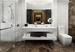 A bathroom at Emporium Hotel South Bank