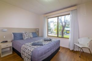 A bed or beds in a room at Wollongong Surf Leisure Resort