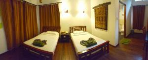 A bed or beds in a room at Borneo Nature Lodge